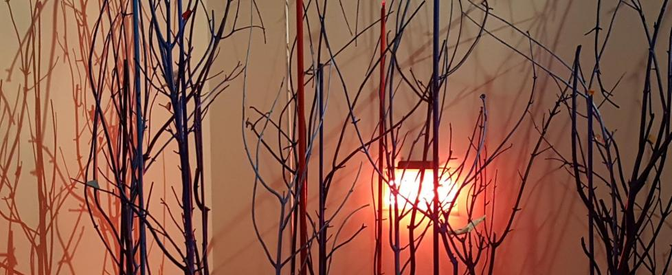 picture. artwork of a neon light among tree branches