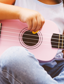 Child with ukulele